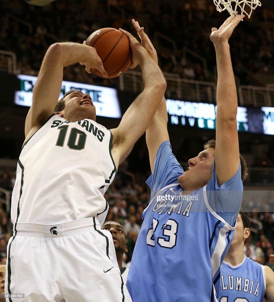 Matt Costello #10 of the Michigan State Spartans drives the ball to the basket while Cory Osetkowski #23 of the Columbia Lions defends during the second half of the game at the Breslin Center on November 15, 2013 in East Lansing, Michigan. Michigan State defeated Columbia 62-53.