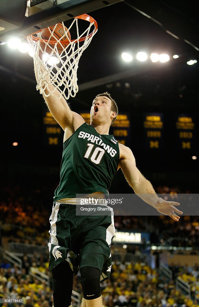 <a gi-track='captionPersonalityLinkClicked' href=/galleries/search?phrase=Matt+Costello+-+Basketball+Player&family=editorial&specificpeople=14309674 ng-click='$event.stopPropagation()'>Matt Costello</a> #10 of the Michigan State Spartans gets to the basket for a second half dunk while playing the Michigan Wolverines at Crisler Center on January 6, 2016 in Ann Arbor, Michigan. Michigan State won the game 89-73.