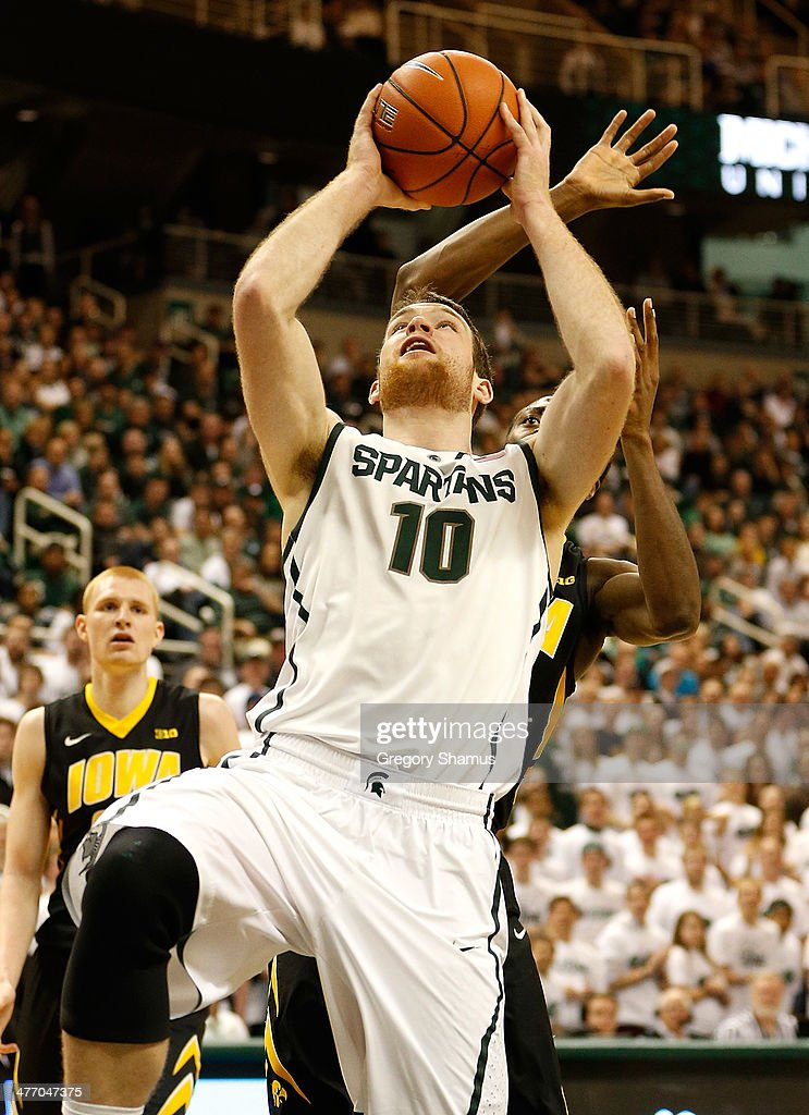 Matt Costello #10 of the Michigan State Spartans tries to get a second half shot off while playing the Iowa Hawkeyes at the Jack T. Breslin Student Events Center on February 6, 2014 in East Lansing, Michigan. Michigan State won the game 86-76.