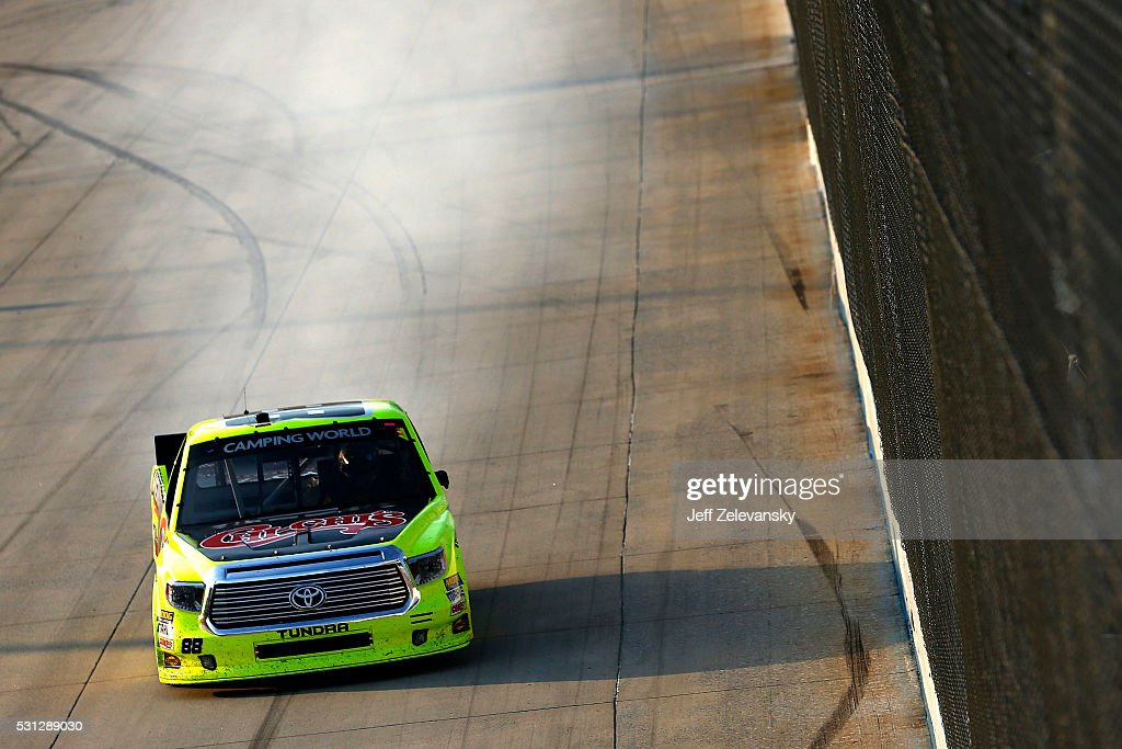 Matt Crafton driver of the ChiChi's/Menards Toyota celebrates after winning the NASCAR Camping World Truck Series JACOB Companies 200 at Dover...