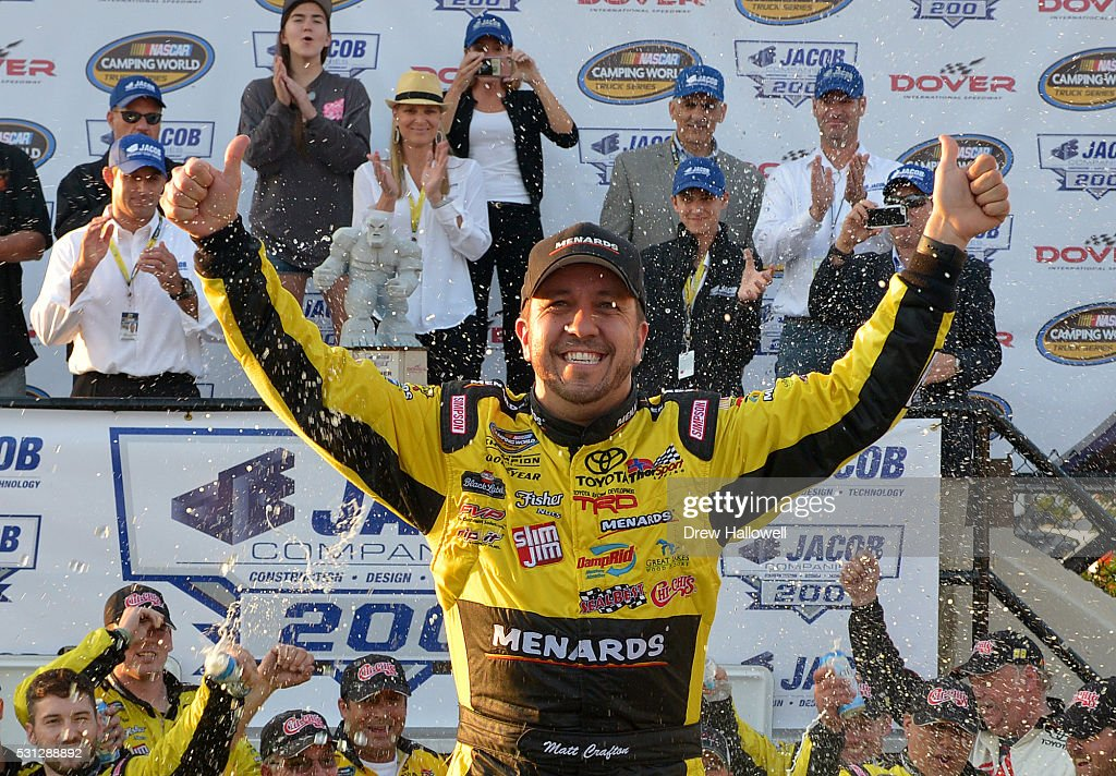 Matt Crafton driver of the ChiChi's/Menards Toyota celebrates in Victory Lane after winning the NASCAR Camping World Truck Series JACOB Companies 200...