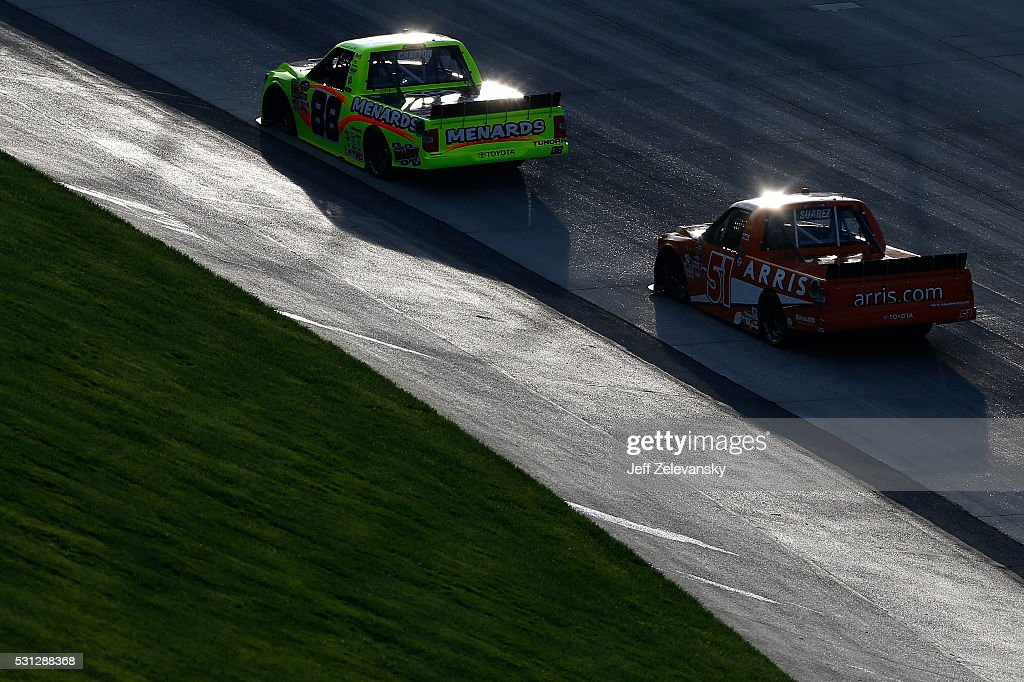 Matt Crafton driver of the ChiChi's/Menards Toyota leads Daniel Suarez driver of the ARRIS Toyota during the NASCAR Camping World Truck Series JACOB...
