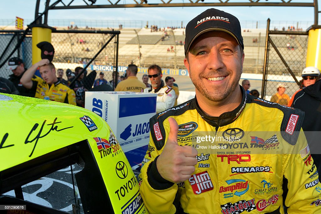 Matt Crafton driver of the ChiChi's/Menards Toyota poses for a picture in Victory Lane after winning the NASCAR Camping World Truck Series JACOB...