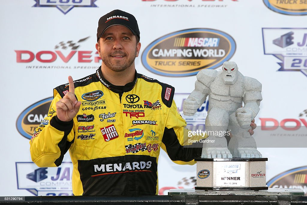 Matt Crafton driver of the ChiChi's/Menards Toyota poses with the trophy in Victory Lane after winning the NASCAR Camping World Truck Series JACOB...