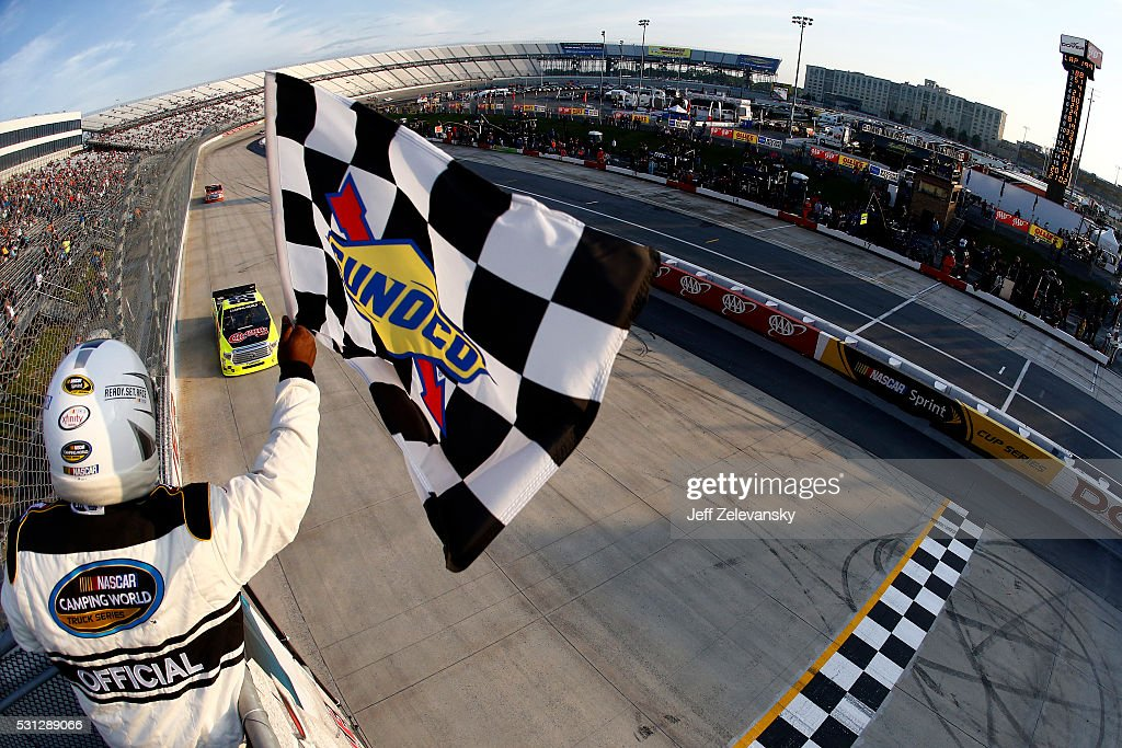 Matt Crafton driver of the ChiChi's/Menards Toyota wins the NASCAR Camping World Truck Series JACOB Companies 200 at Dover International Speedway on...
