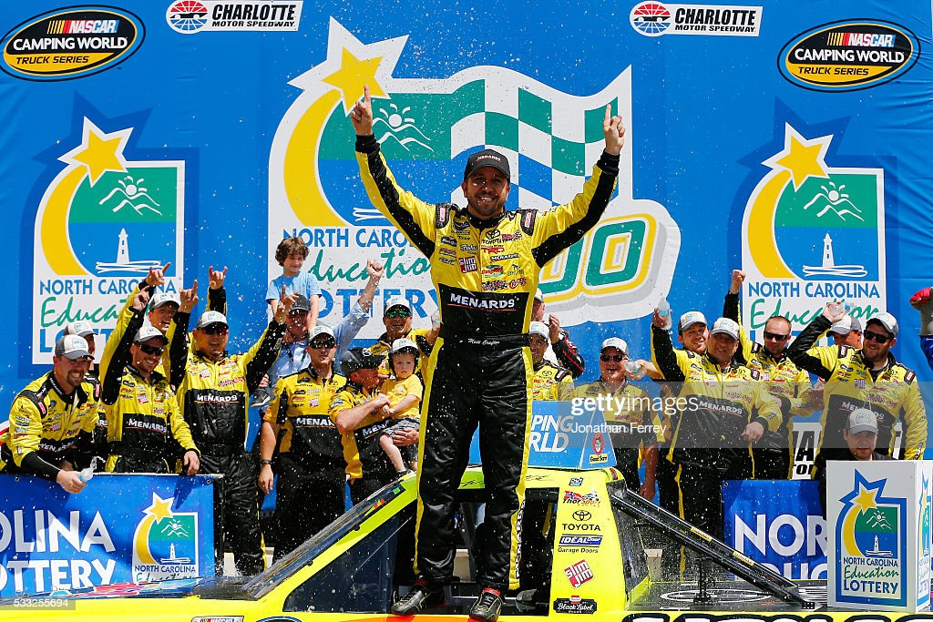 Matt Crafton driver of the Damp Rid/Menards Toyota celebrates in Victory Lane after winning the NASCAR Camping World Truck Series North Carolina...