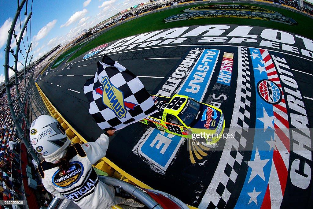 Matt Crafton driver of the Damp Rid/Menards Toyota crosses the finishline to win the NASCAR Camping World Truck Series North Carolina Education...