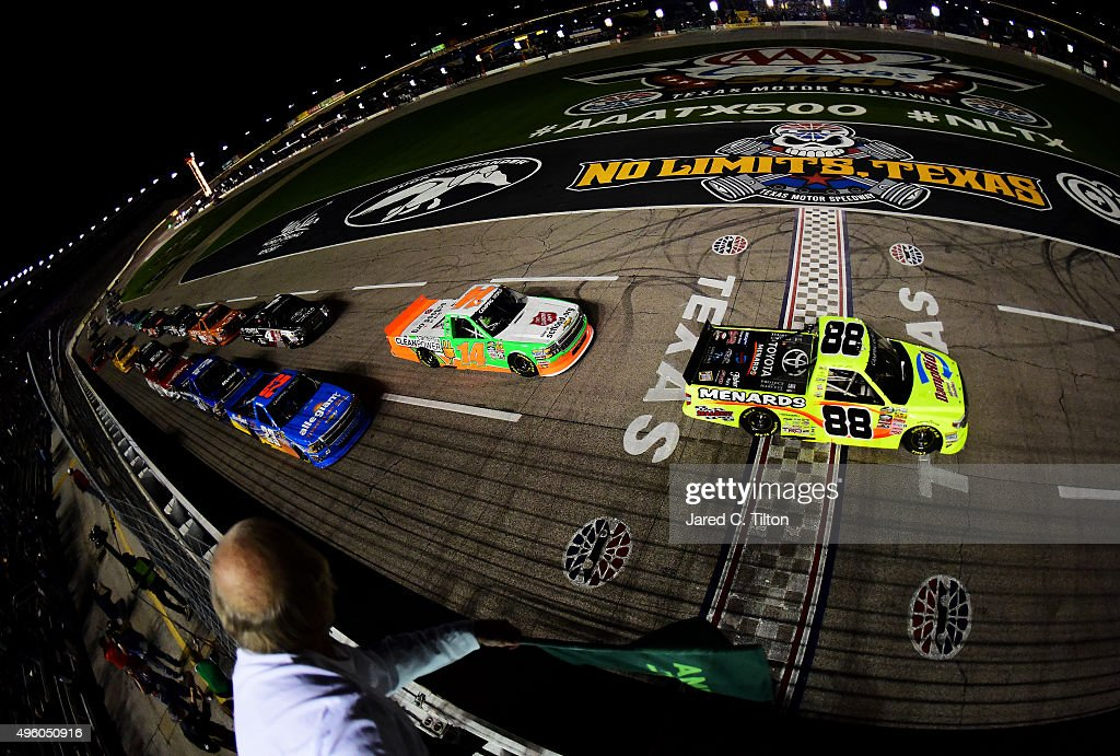 Matt Crafton driver of the Damp Rid/Menards Toyota leads the field past the green flag to start the NASCAR Camping World Truck Series WinStar World...
