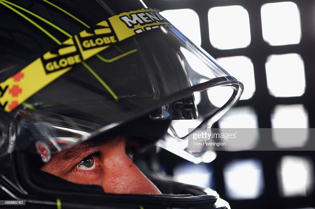 Matt Crafton driver of the Damp Rid/Menards Toyota sits in his truck in the garage area during practice for the NASCAR Camping World Truck Series...