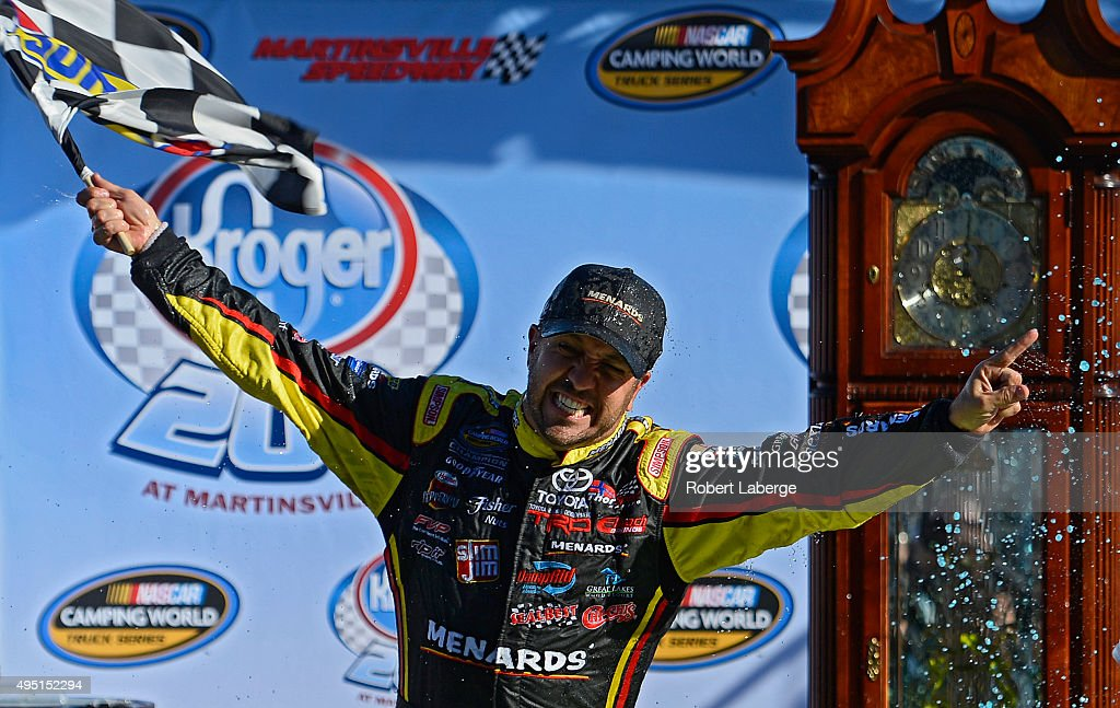 Matt Crafton driver of the Fisher Nuts/Menards Toyota celebrates in victory lane after winning during the NASCAR Camping World Truck Series Kroger...