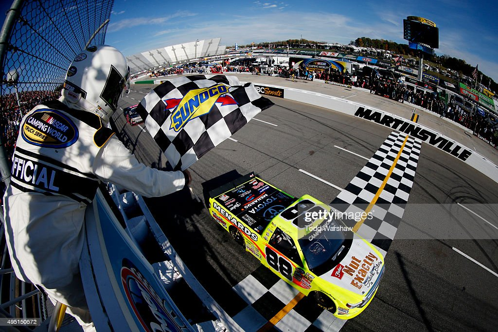 Matt Crafton driver of the Fisher Nuts/Menards Toyota takes the checkered flag to win the NASCAR Camping World Truck Series Kroger 200 at...