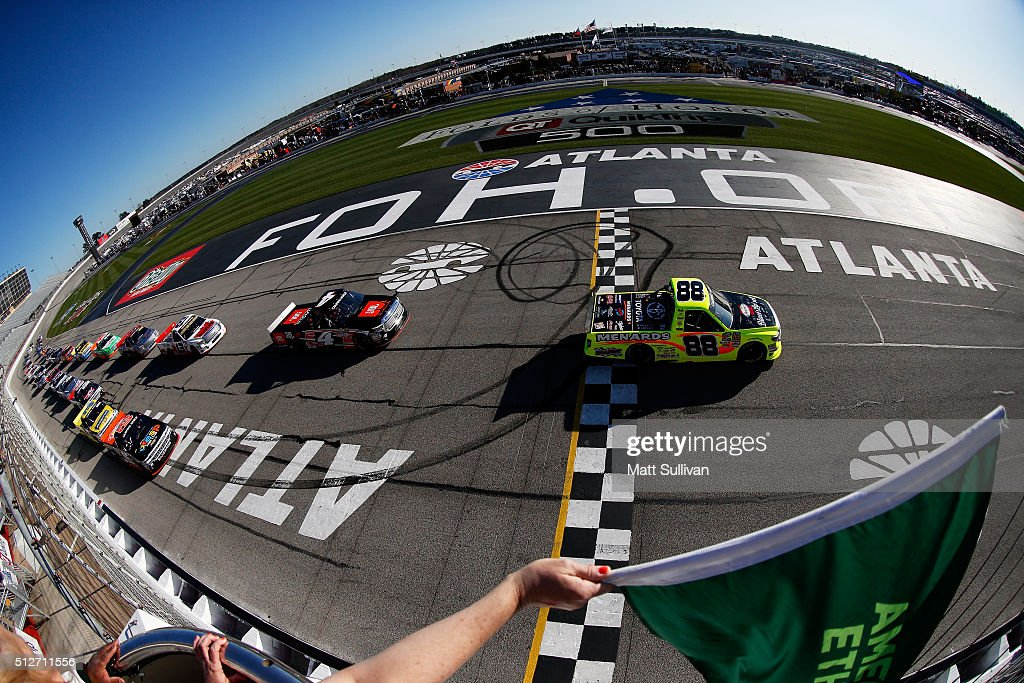 Matt Crafton driver of the Hormel/Menards Toyota leads the field past the green flag to start the NASCAR Camping World Truck Series Great Clips 200...
