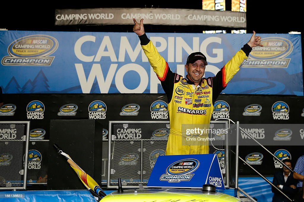 Matt Crafton driver of the Ideal Door / Menards Toyota celebrates in Champions Victory Lane after winning the series championship in the NASCAR...