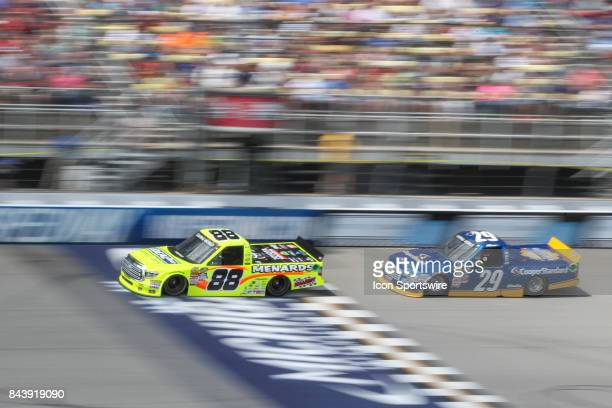Matt Crafton driver of the Ideal Door/Menards Toyota and Chase Briscoe driver of the Cooper Standard Ford race during the Camping World Truck Series...