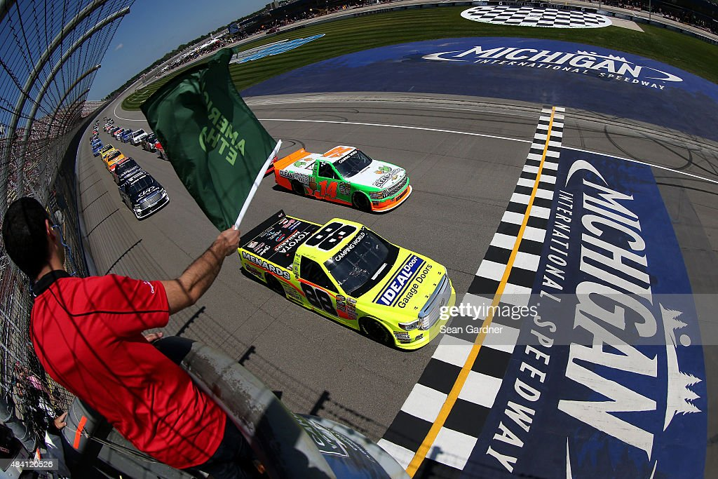 Matt Crafton driver of the Ideal Door/Menards Toyota and Daniel Hemric driver of the California Clean Power Chevrolet lead the field to the green...