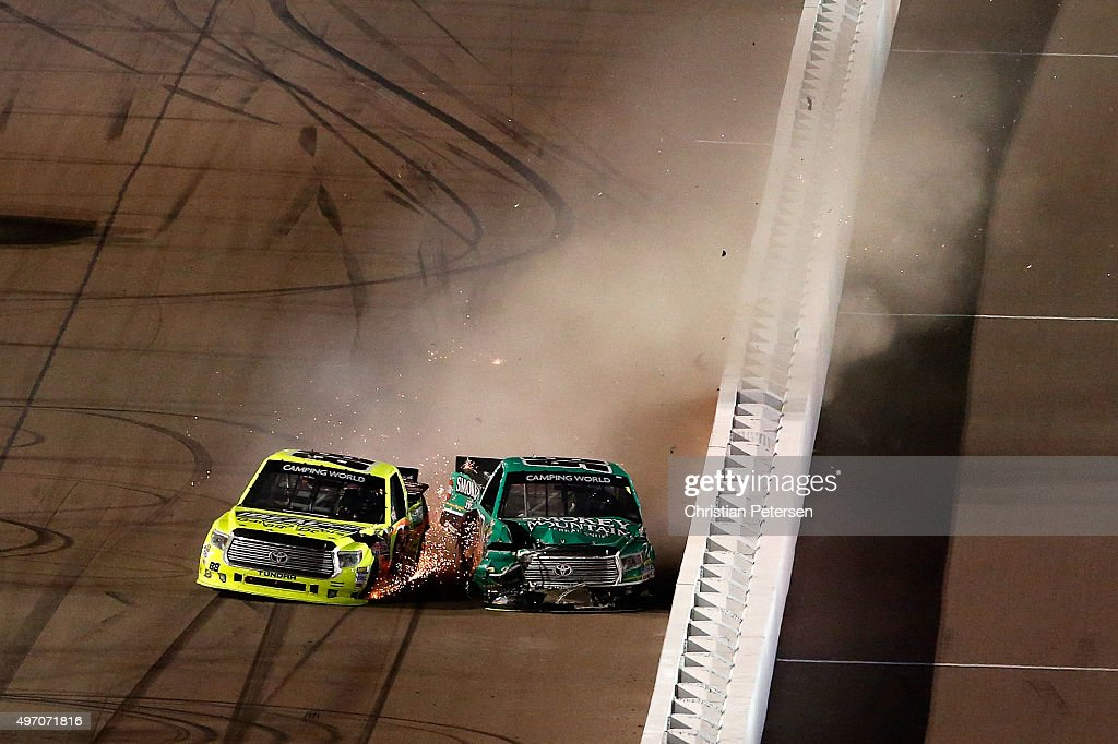 Matt Crafton driver of the Ideal Door/Menards Toyota and Johnny Sauter driver of the Smokey Mountain/Curb Records Toyota crash during the NASCAR...