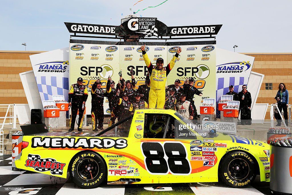 <a gi-track='captionPersonalityLinkClicked' href=/galleries/search?phrase=Matt+Crafton&family=editorial&specificpeople=561821 ng-click='$event.stopPropagation()'>Matt Crafton</a>, driver of the #88 Ideal Door/Menards Toyota, celebrates in Victory Lane after winning the NASCAR Camping World Truck Series SFP 250 at Kansas Speedway on April 20, 2013 in Kansas City, Kansas.