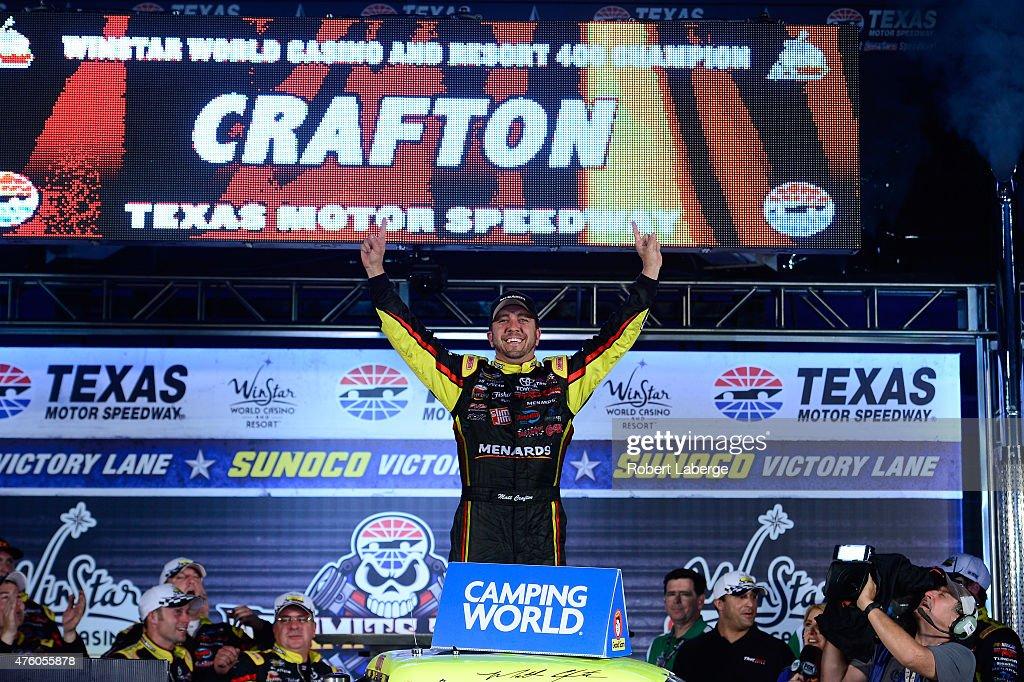 Matt Crafton driver of the Ideal Door/Menards Toyota celebrates in victory lane after winning the NASCAR Camping World Truck Series WinStar World...