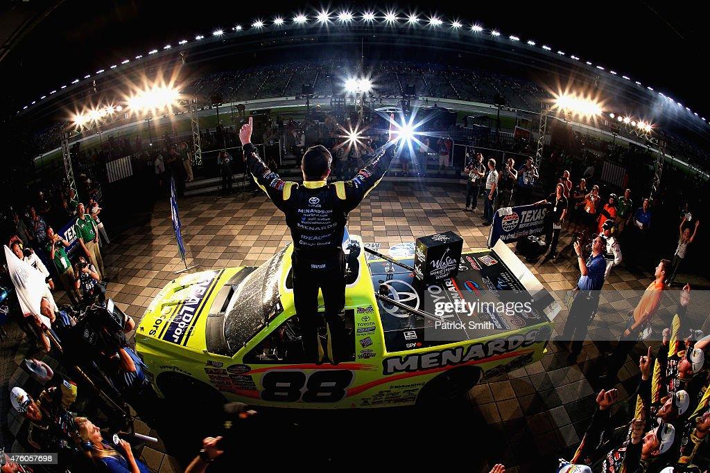 Matt Crafton driver of the Ideal Door/Menards Toyota celebrates in victor lane after winning the NASCAR Camping World Truck Series WinStar World...