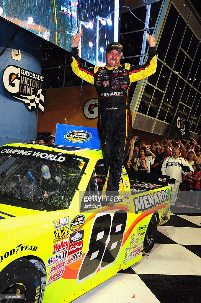 Matt Crafton driver of the Ideal Door/Menards Toyota celebrates in Victory Lane after winning the NASCAR Camping World Truck Series Ford EcoBoost 200...