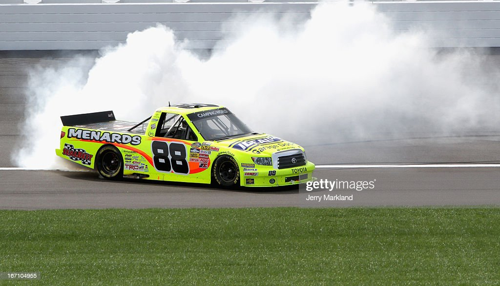 <a gi-track='captionPersonalityLinkClicked' href=/galleries/search?phrase=Matt+Crafton&family=editorial&specificpeople=561821 ng-click='$event.stopPropagation()'>Matt Crafton</a>, driver of the #88 Ideal Door/Menards Toyota, celebrates with a burnout after winning the NASCAR Camping World Truck Series SFP 250 at Kansas Speedway on April 20, 2013 in Kansas City, Kansas.