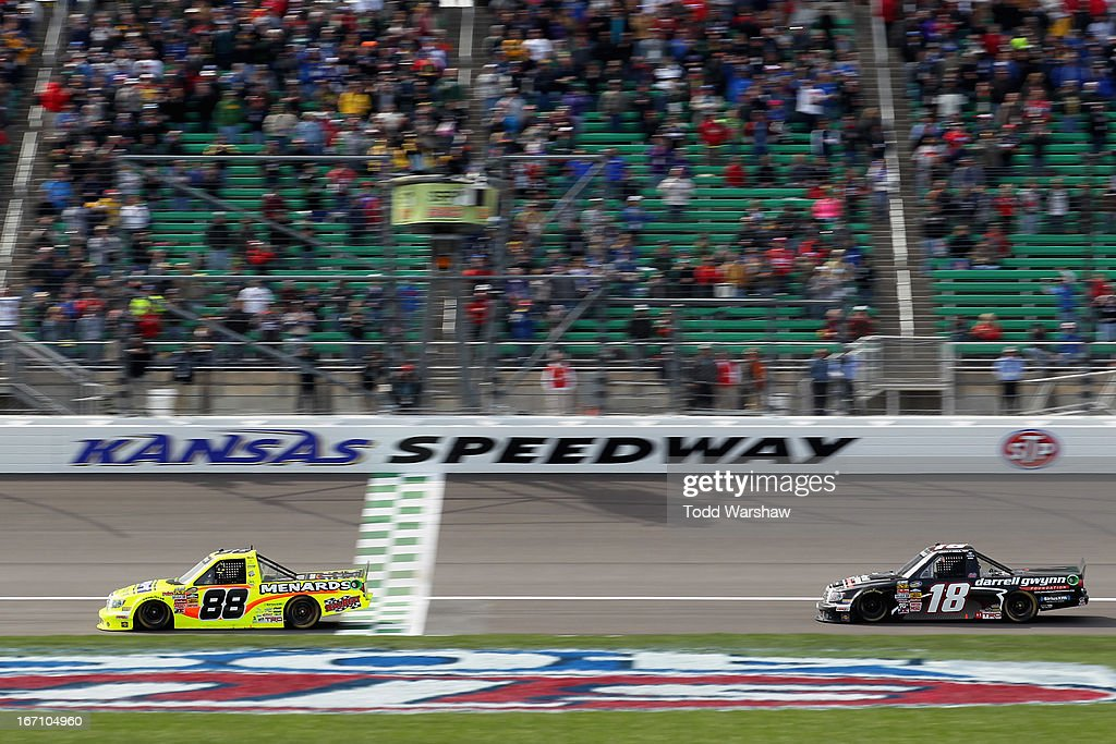 <a gi-track='captionPersonalityLinkClicked' href=/galleries/search?phrase=Matt+Crafton&family=editorial&specificpeople=561821 ng-click='$event.stopPropagation()'>Matt Crafton</a>, driver of the #88 Ideal Door/Menards Toyota, crosses the finish line ahead of Joey Coulter, driver of the #18 Darrell Gwynn Foundation Toyota, to win the NASCAR Camping World Truck Series SFP 250 at Kansas Speedway on April 20, 2013 in Kansas City, Kansas.