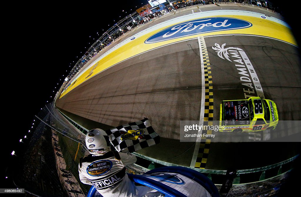 Matt Crafton driver of the Ideal Door/Menards Toyota crosses the finish line to win the NASCAR Camping World Truck Series Ford EcoBoost 200 at...
