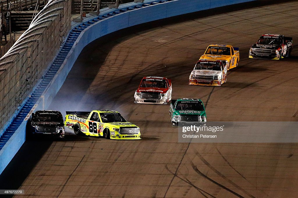 Matt Crafton driver of the Ideal Door/Menards Toyota hits Erik Jones driver of the Toyota Certified Used Vehicles Toyota during the NASCAR Camping...