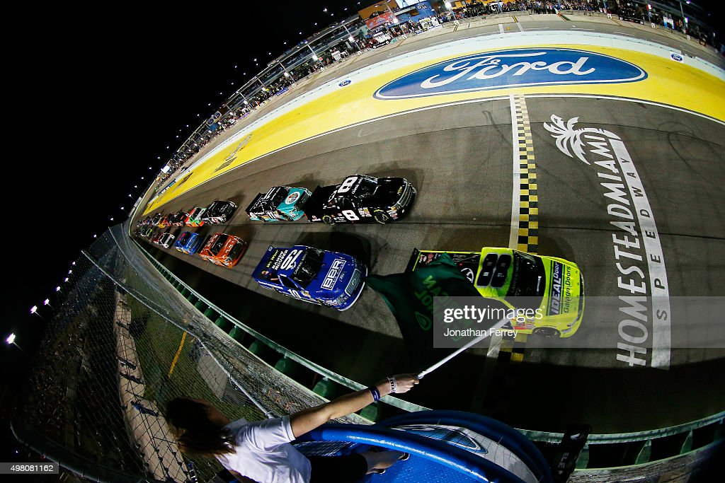 Matt Crafton driver of the Ideal Door/Menards Toyota leads the field past the green flag to start the NASCAR Camping World Truck Series Ford EcoBoost...