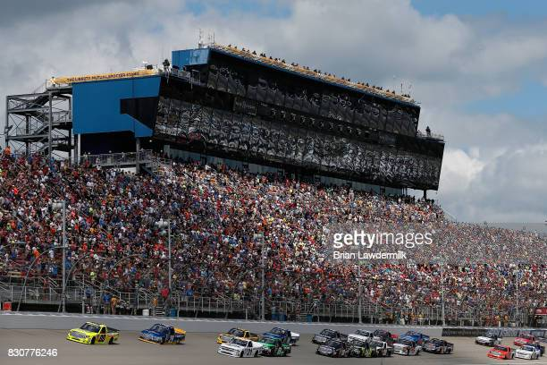 Matt Crafton driver of the Ideal Door/Menards Toyota leads the field past the green flag at the start of the NASCAR Camping World Truck Series LTi...