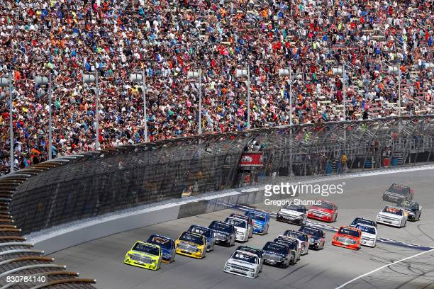 Matt Crafton driver of the Ideal Door/Menards Toyota leads the field past the green flag to start the NASCAR Camping World Truck Series LTi Printing...