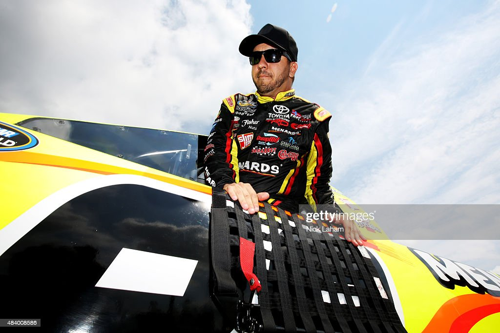Matt Crafton driver of the Ideal Door/Menards Toyota prepares to drive during practice for the NASCAR Camping World Truck Series Careers for Veterans...