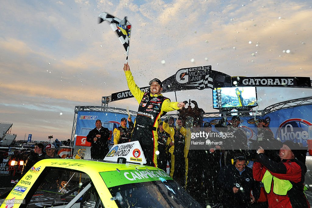 Matt Crafton driver of the Ideal Doors / Menards Toyota celebrates in victory lane after winning the NASCAR Camping World Truck Series Kroger 250 at...