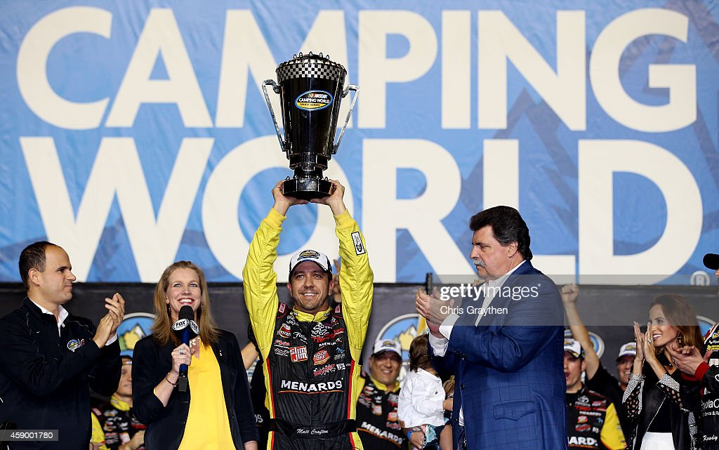 Matt Crafton driver of the JeldWen/Menards Toyota celebrates in Victory Lane after winning the series championship and placing ninth in the NASCAR...