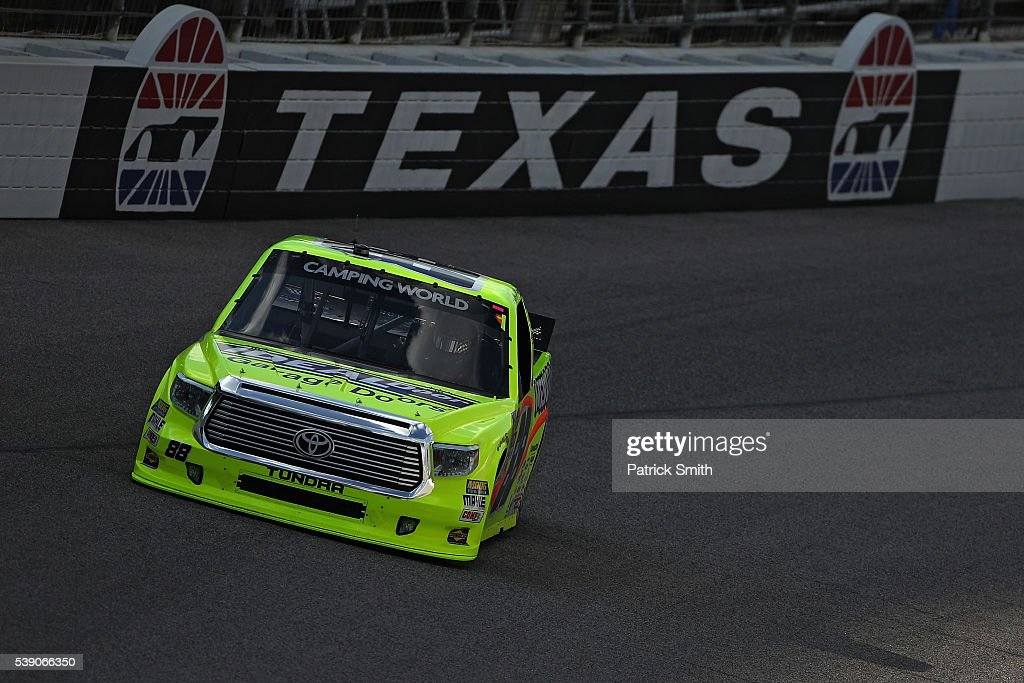 Matt Crafton driver of the Menards Toyota drives during practice for the NASCAR Camping World Truck Series Rattlesnake 400 at Texas Motor Speedway on...