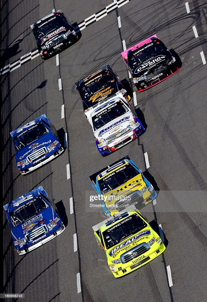 <a gi-track='captionPersonalityLinkClicked' href=/galleries/search?phrase=Matt+Crafton&family=editorial&specificpeople=561821 ng-click='$event.stopPropagation()'>Matt Crafton</a>, driver of the #88 Menards Toyota, leads a pack of trucks during the NASCAR Camping World Truck Series Kroger 200 at Martinsville Speedway on October 26, 2013 in Martinsville, Virginia.