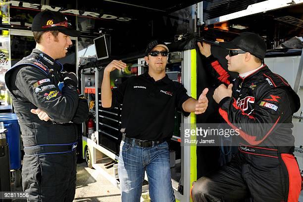 Matt Crafton driver of the Menards/McGuireNicholas Chevrolet talks with David Gilliland driver of the Menards Chevrolet and Brian Scott driver of the...