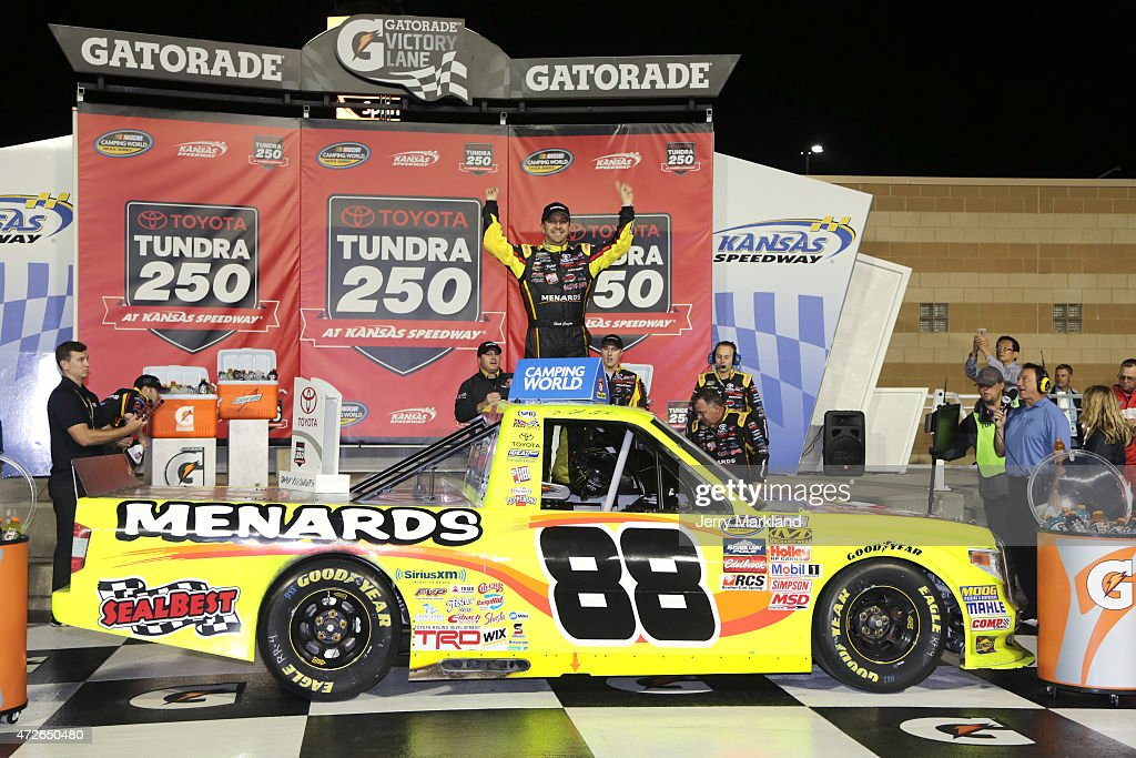 Matt Crafton driver of the Slim Jim/Menards Toyota celebrates in Victory Lane after winning the NASCAR Camping World Truck Series Toyota Tundra 250...