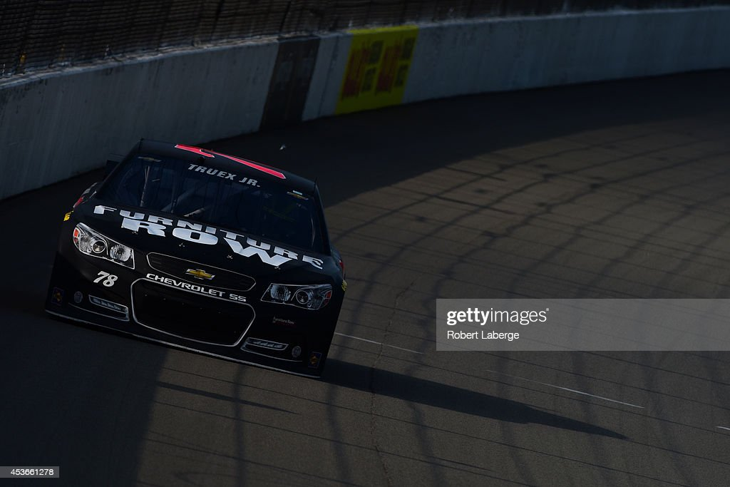 <a gi-track='captionPersonalityLinkClicked' href=/galleries/search?phrase=Matt+Crafton&family=editorial&specificpeople=561821 ng-click='$event.stopPropagation()'>Matt Crafton</a>, temporary driver of the #78 Furniture Row Chevrolet, during qualifying for the NASCAR Sprint Cup Series Pure Michigan 400 at Michigan International Speedway on August 15, 2014 in Brooklyn, Michigan.