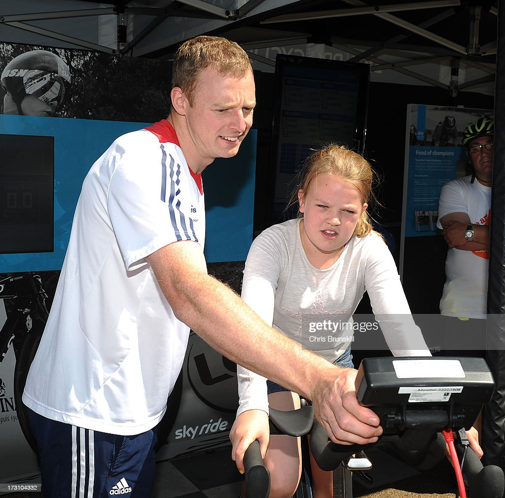 Matt Crampton assists a competitor during the Bike Watt Challenge at Sky Ride Leeds today - a free, fun, family cycling event from British Cycling and Sky held in partnership with Leeds City Council, offering people of all ages and abilities the chance to cycle around a traffic-free city on July 7, 2013 in Leeds, England. The ride celebrated the fact that the Tour de France will start in Leeds in 2014. Find a free organised bike ride near you and see how you can get involved at www.goskyride.com - there's something for everyone.