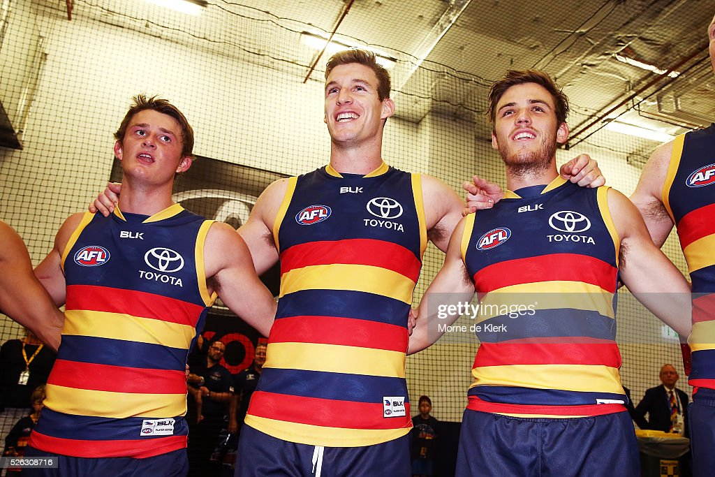 Matt Crouch, Josh Jenkins and Paul Seedsman of the Crows celebrate after the round six AFL match between the Adelaide Crows and the Fremantle Dockers at Adelaide Oval on April 30, 2016 in Adelaide, Australia.