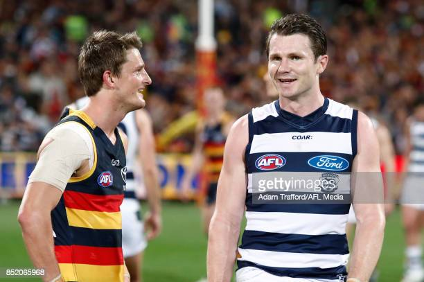 Matt Crouch of the Crows chats to form Crows teammate Patrick Dangerfield of the Cats during the 2017 AFL First Preliminary Final match between the...