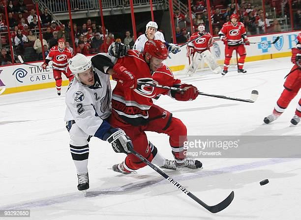 Matt Cullen of the Carolina Hurricanes battles for the puck against Lukas Krajicek of the Tampa Bay Lightning during an NHL game on November 21 2009...