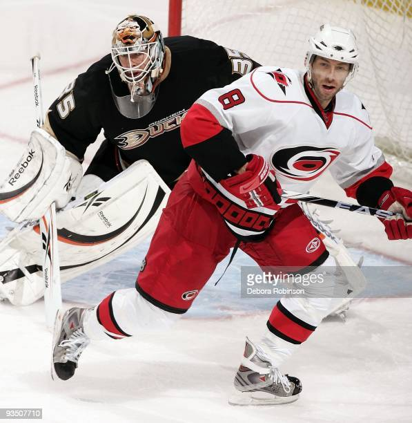 Matt Cullen of the Carolina Hurricanes defends outside the crease against JeanSebastien Giguere of the Anaheim Ducks during the game on November 25...