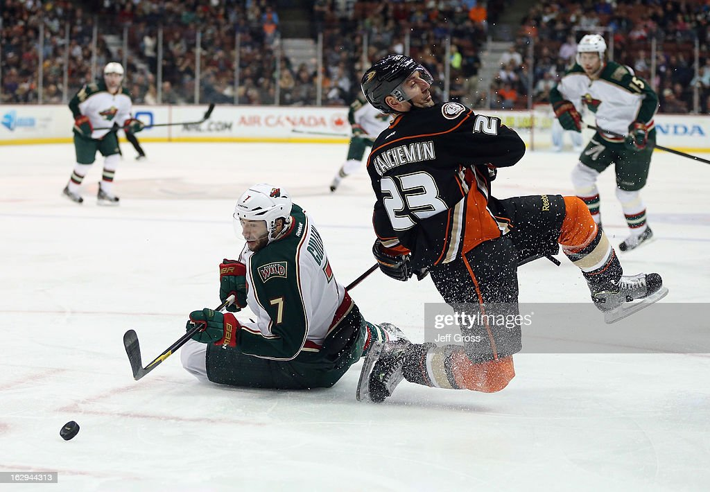 Matt Cullen #7 of the Minnesota Wild and Francois Beauchemin #23 of the Anaheim Ducks get tangled up while pursuing the puck in the second period at Honda Center on March 1, 2013 in Anaheim, California.