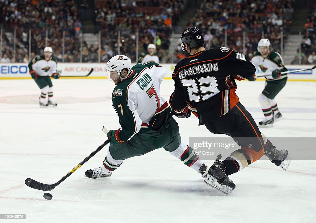 Matt Cullen #7 of the Minnesota Wild and Francois Beauchemin #23 of the Anaheim Ducks get tangled up while pursuing the puck in the second period at Honda Center on March 1, 2013 in Anaheim, California. The Ducks defeated the Wild 3-2.