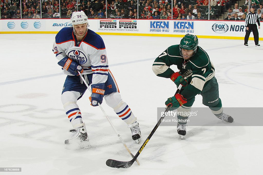 <a gi-track='captionPersonalityLinkClicked' href=/galleries/search?phrase=Matt+Cullen&family=editorial&specificpeople=536122 ng-click='$event.stopPropagation()'>Matt Cullen</a> #7 of the Minnesota Wild and <a gi-track='captionPersonalityLinkClicked' href=/galleries/search?phrase=Ryan+Smyth+-+Ice+Hockey+Player&family=editorial&specificpeople=202567 ng-click='$event.stopPropagation()'>Ryan Smyth</a> #94 of the Edmonton Oilers battle for the puck during the game on April 26, 2013 at the Xcel Energy Center in St. Paul, Minnesota.