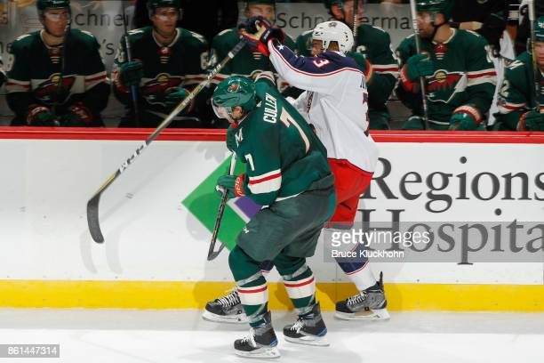 Matt Cullen of the Minnesota Wild and Seth Jones of the Columbus Blue Jackets skate to the puck during the game at the Xcel Energy Center on October...