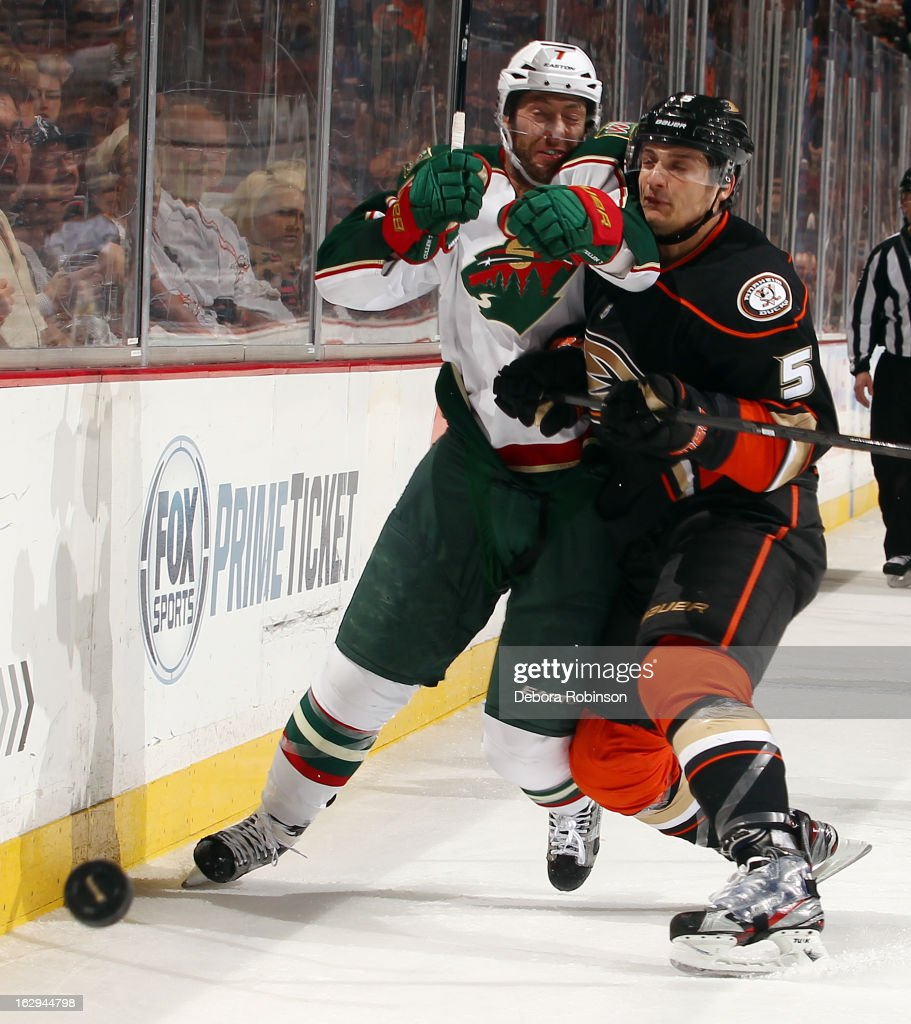 Matt Cullen #7 of the Minnesota Wild battles for the puck against Luca Sbisa #5 of the Anaheim Ducks on March 1, 2013 at Honda Center in Anaheim, California.