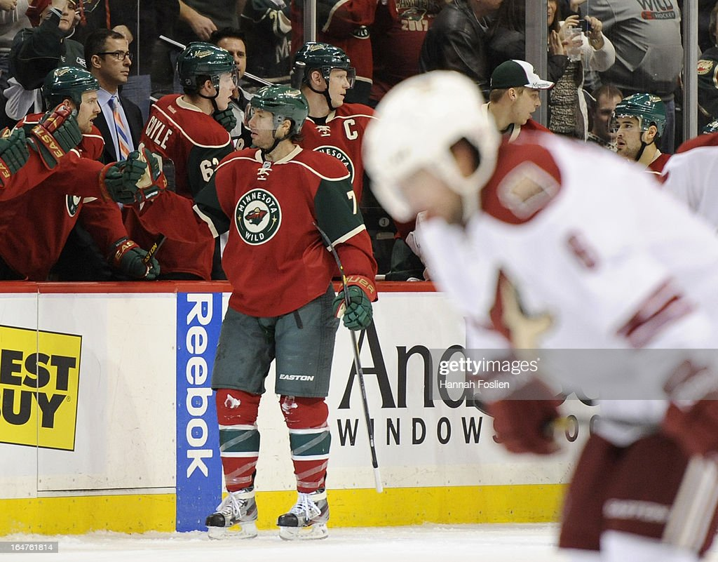 Matt Cullen #7 of the Minnesota Wild celebrates scoring a goal as David Schlemko #6 of the Phoenix Coyotes skates back to his bench during the second period of the game on March 27, 2013 at Xcel Energy Center in St Paul, Minnesota.